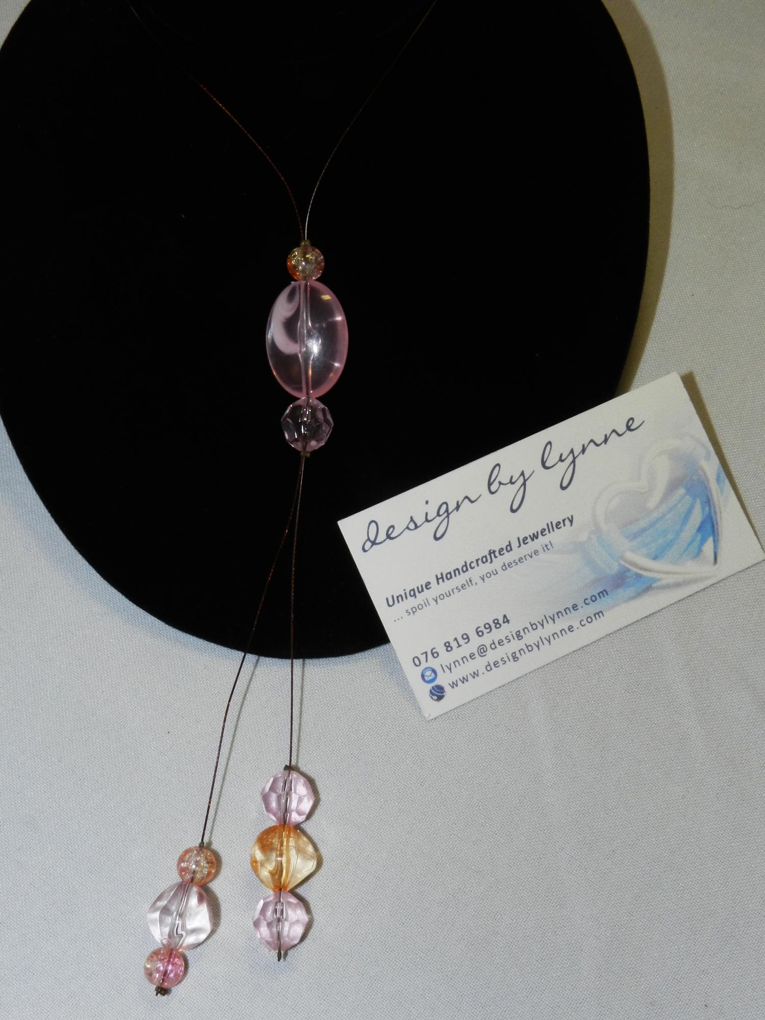 Pink and Orange Beads on Tiger Wire